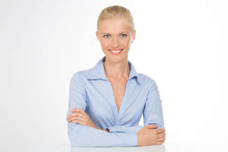 ambitious woman smiling at work photo