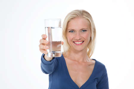 beautiful woman shows glass of mineral water