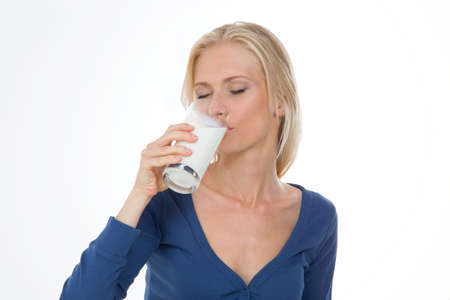 energized: beautiful woman have breakfast with glass of energized milk Stock Photo