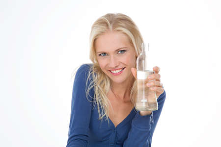 pretty woman shows her bottle of pure water photo