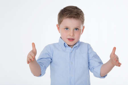 male kid shows the measure of something Stock Photo