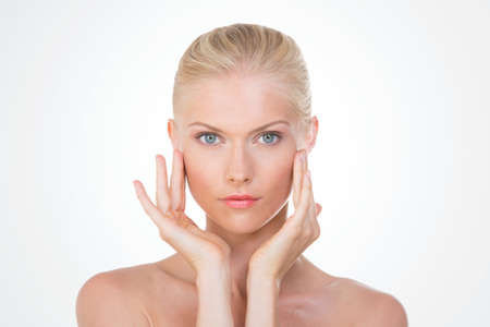 eye massage: blond girl with hands on her face Stock Photo
