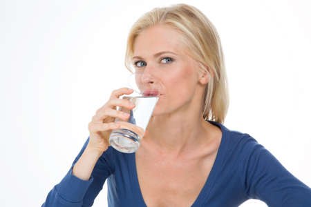 purify: pretty woman thirsts herself with some fresh and cool water Stock Photo