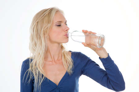 beautiful lady drinks water after her gym exercise photo