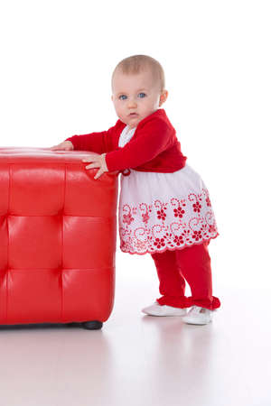 wildcard: little baby girl lean on a red puff