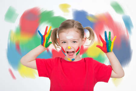 twister: young child with a twister of colours behind her screaming Stock Photo