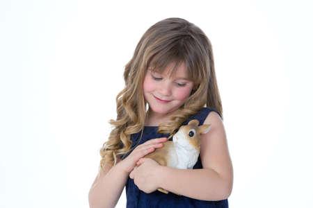 caresses: beautiful girl caresses her little bunny
