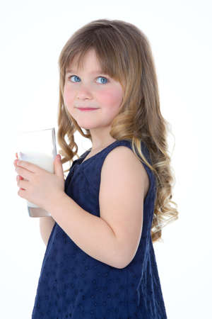 girl looks at someone and drinks some fresh milk photo