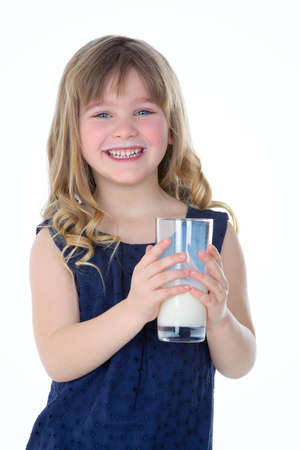 milk mustache: young girl happy to drink a glass of fresh milk