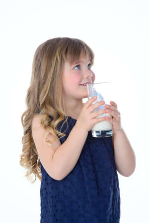 someone: little child looks at someone while drinking some milk Stock Photo