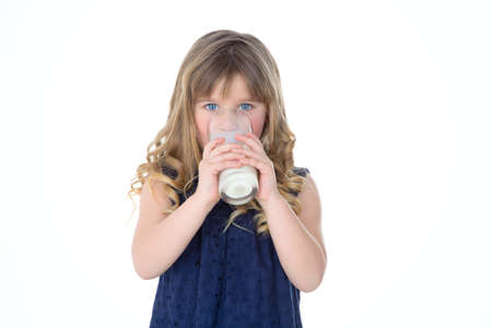 refreshes: little girl refreshes herself with cold milk