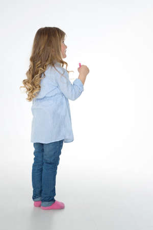 little girl barefoot: blond girl thinking about her drawing