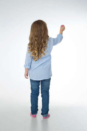 little child thinks about what to represent