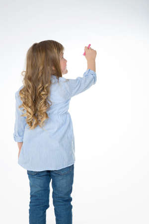 kid pointing: little girl thinks about her next drawing