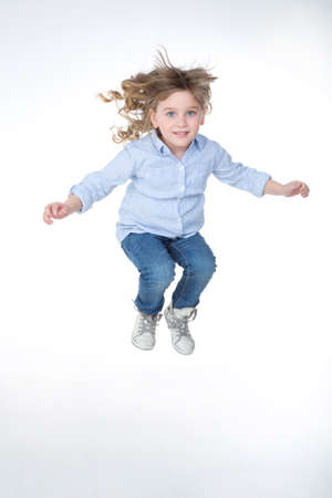 self confidence: young girl make a jump with self confidence