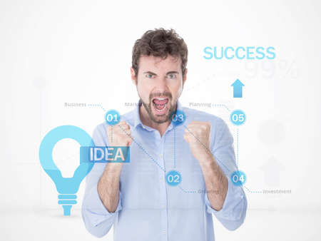 exult: one man with hands up exulting for his success in business in front of financial sketches Stock Photo