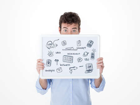 young guy covering his face with a banner with icon of electronic devices Stock Photo