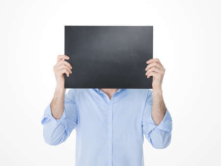 one adult: one adult holding a black banner in front of his head