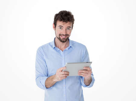 technologic: one guy holding and using one grey tablet Stock Photo