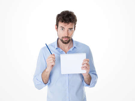 young man in casual clothes showing a white page of a notebook photo