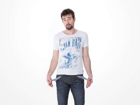 Jeune homme présentant ses poches vides Banque d'images - 37230507