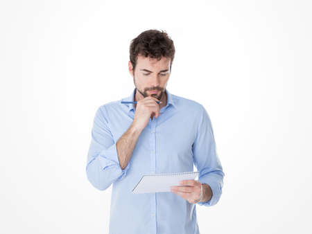 guy with hand on his chin reviewing his notes