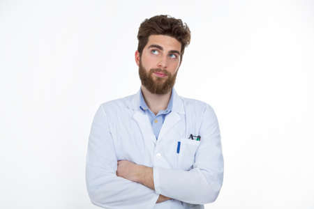 making a face: caucasian male wearing lab coat looking up making a face Stock Photo