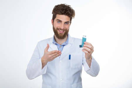 hypersensitivity: young doctor showing a drug to his patient Stock Photo
