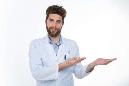 self confident: self confident practitioner at work with a lab coat standing in front of the camera Stock Photo