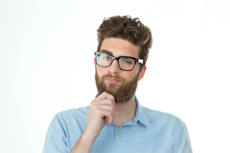bearded young man thinking  doubtfully and looking at the camera Banque d'images