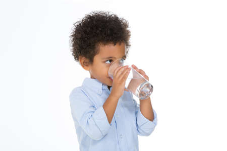 african child holding a glass standing in front of with background
