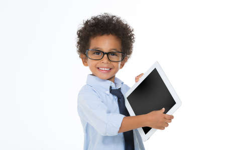 little business man: little business man holding a tablet and smiling isolated on white background