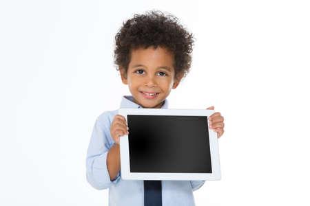 sweet child showing something on his notepad isolated on white background