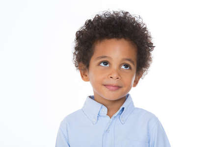 adorable boy looking to something with thoughtful expression Imagens