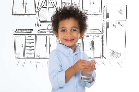 one child: smiling child posing in front of a drawing kitchen