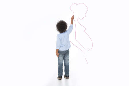 little child drawing his mum on the wall with chalk