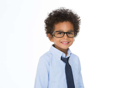 smiling kid with tie posing on a with background