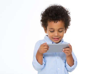 african schoolboy using smartphone against white background