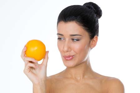 girl with fruit in her hands Imagens
