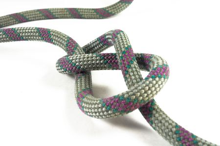 A climbers figure eight knot is isolatied against a white backg ground Standard-Bild