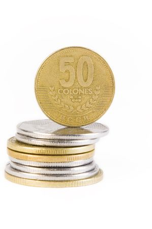 Colones, the currency of Costa Rica, are stacked and isolated against a white background