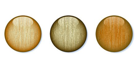 A set of three light colored glossy wooden buttons.