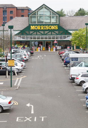 car retailer: AYLESBURY, ENGLAND - JULY 21: The car park and entrance to Morrisons supermarket at Aylesbury, Buckinghamshire on July 21, 2014. Morrisons has entered a price war with other leading supermarket brands, in the face of increasing competition from Aldi and L Editorial