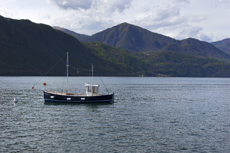 orta: Boat on the Orta lake, Italy.