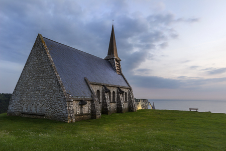 Notre Dame de la Garde church at sunset in Etretat, Normandy, France.
