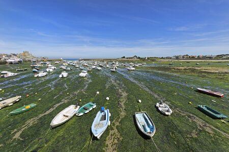 Low tide in Barfleur, Normandy, France. Stock Photo