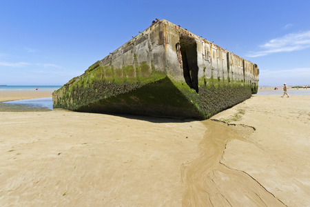 ARROMANCHES, FRANCE - JUNE 2014; Remains of the temporary harbor used during the Second World War.