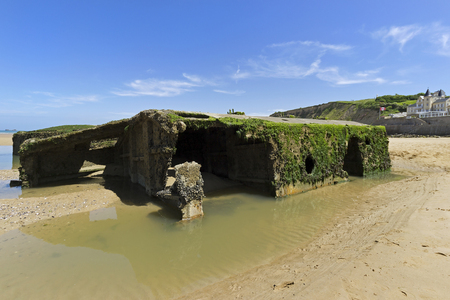 allies: ARROMANCHES, FRANCE - JUNE 2014; Remains of the temporary harbor used during the Second World War.