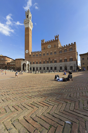 SIENA, ITALY - OCTOBER 2013; Piazza del Campo in Siena, the famous square of the Palio.