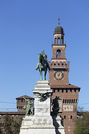 sforza: Giuseppe Garibaldi monument and the bell tower of Sforza Castle in MIlan, Italy.